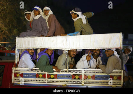 Minya, Egypt. 28th May, 2015. Egyptian quarry workers are transported with a truck to their work in the early morning - Stock Photo