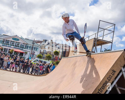 Skateboarder showing off his skills on a special purpose deck at the Wheels Festival in Bournemouth, Dorset, England, - Stock Photo