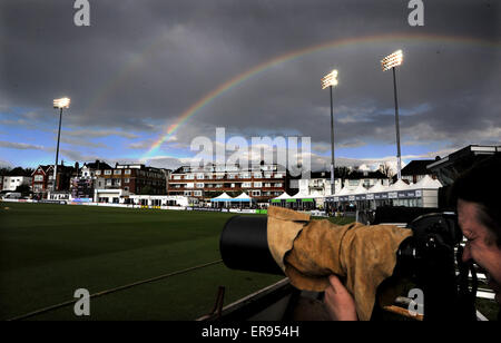 Brighton UK Friday 29th May 2015 - A beautiful rainbow lights up the dark sky above Sussex county cricket ground - Stock Photo