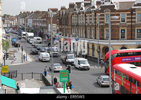 Lee Bridge Road, a busy suburban high street in North London showing traffic congestion, buses and pedestrians - Stock Photo