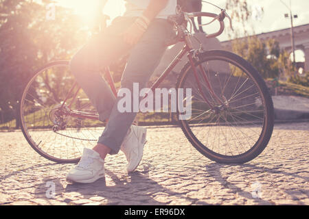 Stylish guy posing with vintage race bike - Stock Photo