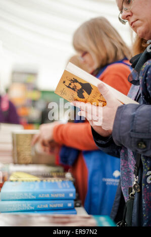 Hay on Wye, UK. Thursday 28 May 2015  Pictured: People Browse the books at Hay  Re: The 2015 Hay Festival takes - Stock Photo
