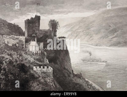 Burg Rheinstein. Castle on hillside overlooking Rhine river, steamboat passing on the river. Date c1901. - Stock Photo
