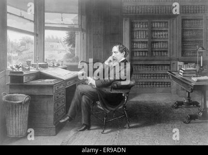 Charles Dickens in his study at Gadshill. Charles Dickens, full-length portrait, seated at desk, facing left, in - Stock Photo
