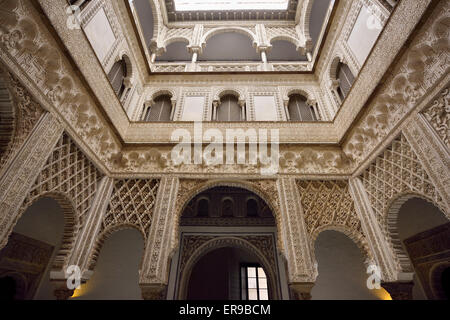 Ornate plasterwork in Courtyard of the Dolls at the Royal Palace Alcazar Seville Andalusia - Stock Photo