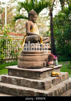 Buddha statues in the resort garden of La Residence d'Angkor, Siem Reap, Cambodia. - Stock Photo