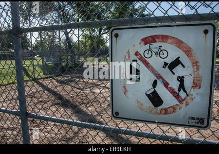 Rusted damaged old sign on a fence restriction no pets, no leather, no food in a park.  Roles to follow to keep - Stock Photo
