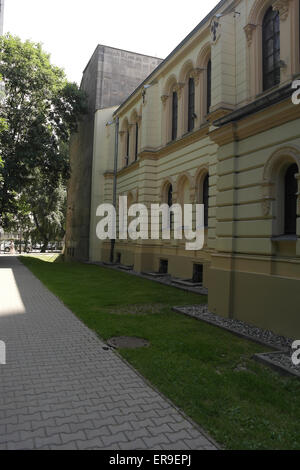 White sky oblique sunny day morning shade portrait north side Nozyk Synagogue, looking east, 6 Twarda Street, Warsaw, - Stock Photo