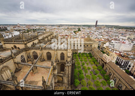 Wide view west from Giralda tower with roof of Seville cathedral and orange tree courtyard Stock Photo