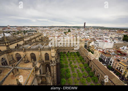 View of Seville city west from Giralda tower Saint Mary of the See cathedral roof and orange tree courtyard Andalusia Spain Stock Photo