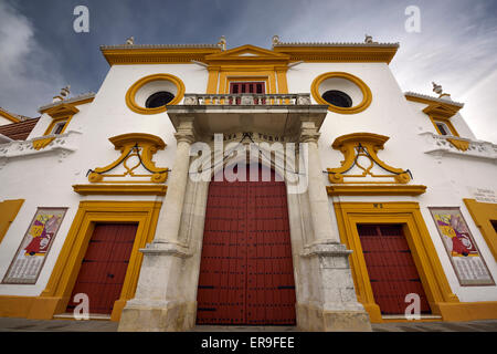 Front doors and baroque facade of the Plaza de Toros Bull fighting ring in Seville Spain - Stock Photo