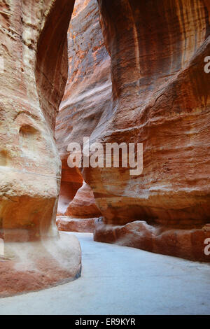 Tunnel between the rocky mountains in the ancient city of Petra, Jordan. - Stock Photo