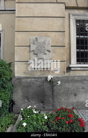 Tchorek memorial plaque about the killing of 430 patients and staff at 1944 Warsaw Uprising Raczynski Palace insurgent - Stock Photo
