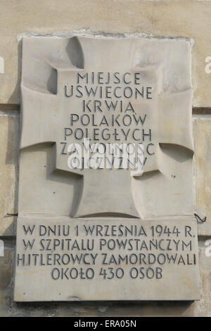 Tchorek Plaque commemorating killing of 430 people by Germans at the 1944 Warsaw Uprising Raczynski Palace insurgent - Stock Photo