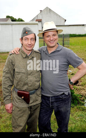 Gerolsbach, Germany. 29th May, 2015. Actor Thorsten Merten (L), who plays GDR National People's Army soldier Ralle - Stock Photo
