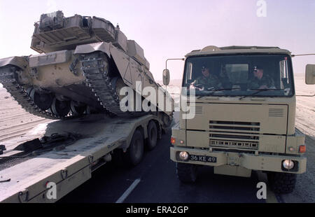 8th January 1991 In eastern Saudi Arabia, a British Challenger 1 Mk 3 tank drives off a Scammell Commander Tank - Stock Photo