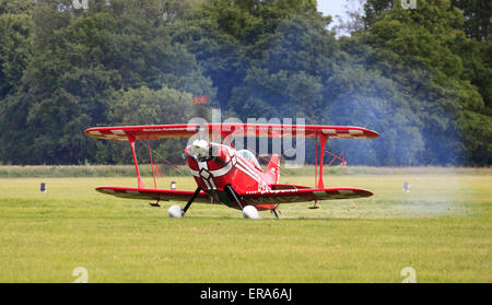 A Pitts Special taxis on the airfield after finishing another breath taking aerial display at the Cosford Airshow - Stock Photo