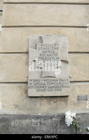 Tchorek Plaque commemorating killing of 430 patients and staff at 1944 Warsaw Uprising Racynski Palace insurgent - Stock Photo