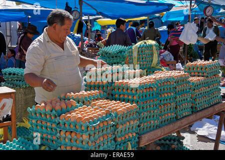 Man selling eggs at Sunday market, Urcos (Cuzco region), Peru - Stock Photo
