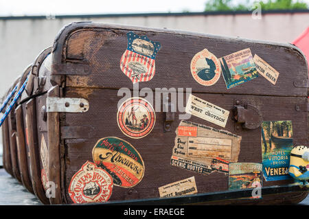 Old trunk with stickers from European holiday destinations. - Stock Photo