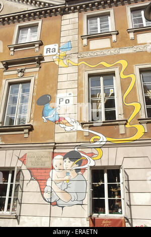 Portrait mural of baby holding test-tube, with radioactive elements rising, Marie Curie birthplace museum, Freta - Stock Photo
