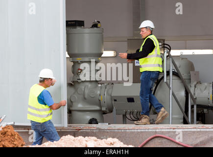 Sofia, Bulgaria - May 29, 2015: Engineers are keeping an eye on the testing of Sofia's second waste plant Heavy - Stock Photo