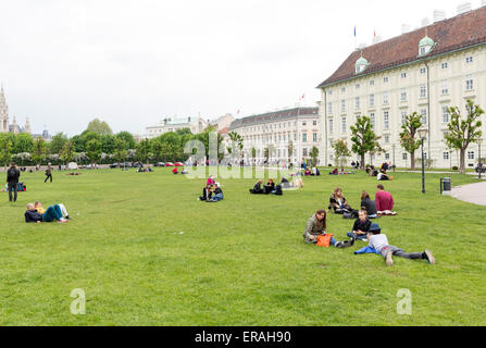 Vienna, Austria - May 1, 2015: Austrian teenagers are spending their free time on a grassy meadow in the center - Stock Photo