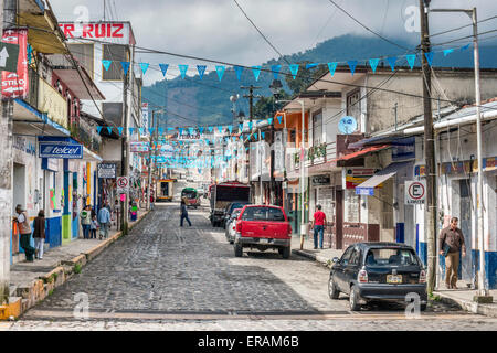 Avenida Nicholas Bravo, cobbled street with utility cables overhead, decorated with pennants, in Coscomatepec, Veracruz, - Stock Photo