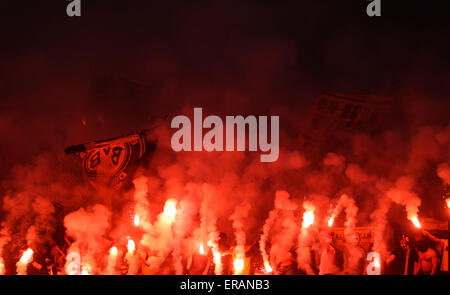 Berlin, Germany. 30th May, 2015. Fans of Borussia Dortmund light fireworks during the German Cup (DFB Pokal) final - Stock Photo
