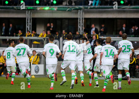 Berlin, Germany. 30th May, 2015. Players of VfL Wolfsburg celebrate for goal during the German Cup (DFB Pokal) final - Stock Photo