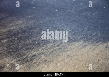 Amazing black sand of  Kerala state, Varkala beach - Stock Photo