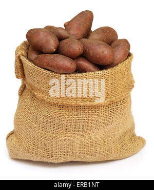 Some red potatoes in a sack bag over white background - Stock Photo