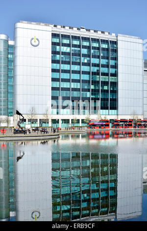 Offices of Global Switch data centre provider reflections in landscaped water feature bus stands Tower Hamlets East - Stock Photo