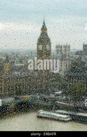 view to Big Ben, Westminster bridge and parliament through the wet window - Stock Photo