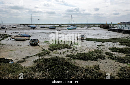 Sail Boats with the tide out on the estuary Leigh on Sea Essex UK - Stock Photo