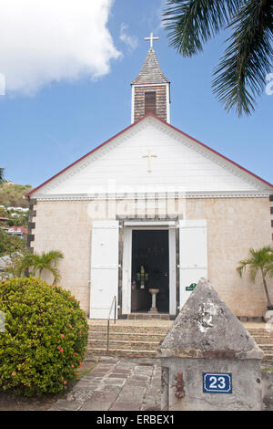 The picturesque, tropical St. Bartholomew's Anglican Church along Rue Samuel Fahlberg in Gustavia, St. Barts - Stock Photo