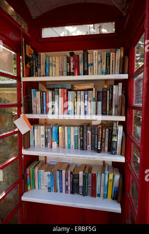 The Thurlestone book exchange, located in an old telephone box in the village od Thurlestone, Devon. - Stock Photo