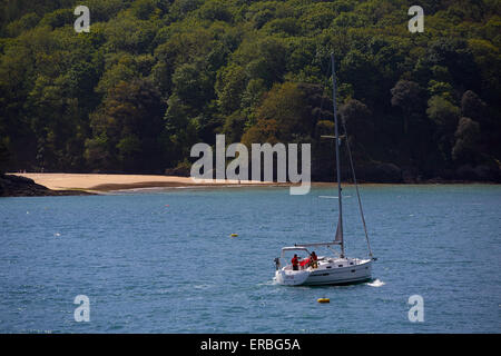 A yacht sailing in Salcombe harbour,Devon,UK. - Stock Photo