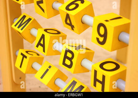 letters and numbers in the form of cubes - Stock Photo