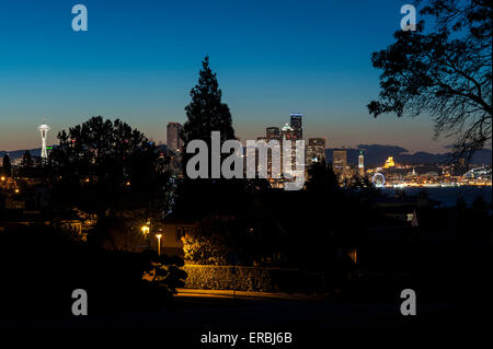 Seattle Skyline from Magnolia Bluff sunrise with city lights - Stock Photo