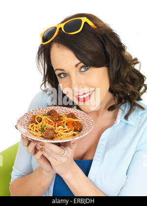 Beautiful Attractive Young Woman in Her Twenties Holding a Plate of Spaghetti and Meatballs - Stock Photo