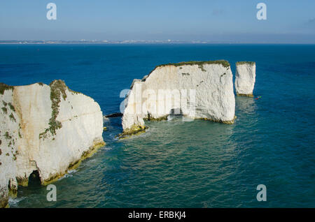 Chalk cliffs at Old Harry Rocks, Swanage, Dorset, UK. Two sea kayaks can be seen near the distant stack. - Stock Photo