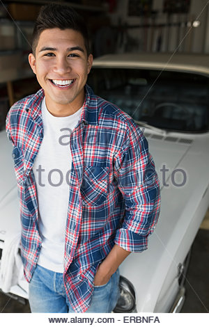 Portrait smiling young man with vintage car - Stock Photo