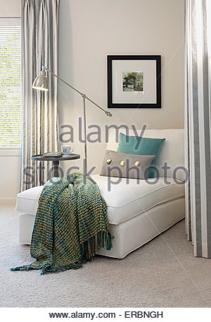 Lamp over chaise lounge - Stock Photo