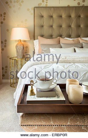 Tea tray on bench end of elegant bed - Stock Photo