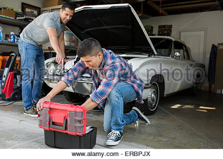 Father repairing car stock photo royalty free image for Ouvrir son garage auto