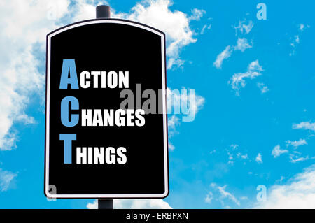 ACT as ACTION CHANGES THINGS  motivational quote written on road sign isolated over clear blue sky background - Stock Photo