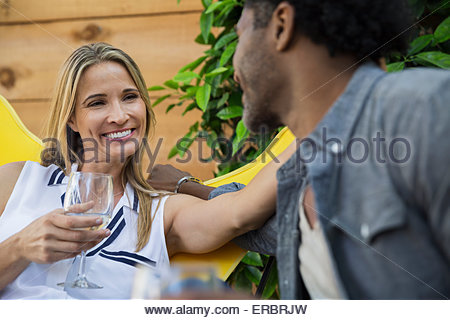 Affectionate couple talking and drinking wine - Stock Photo