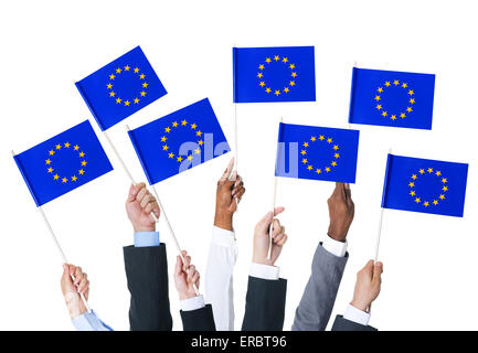 Business people holding the flag of the European Union. - Stock Photo