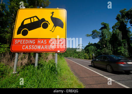 A sign warning motorists to be careful of the endangered cassowary when driving on Mission Beach roads, far north - Stock Photo